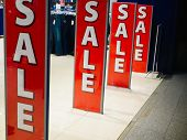 Entrance To The Store With Sales. Bright Sign Sale At The Entrance To The Store In The Shopping Cent poster