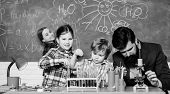 Happy Children Teacher. Experimenting With Chemicals Or Microscope At Laboratory. Biology Education. poster