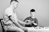 Medicine And Health. Childhood. Parenting. Family Doctor. Father And Son In Medical Uniform. Happy K poster