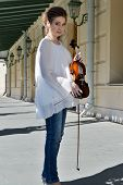 Pregnant Girl In A White Blouse. Blonde Girl. Young Girl. In Blue Jeans. Girl With A Violin. poster