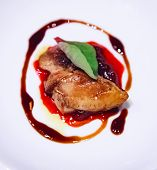 Selective Focused Pan Seared Foie Gras With Berry Sauce Decoration Served On White Porcelain Plate.  poster
