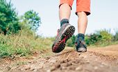 Trekking Boot Sole Close Up Image Traveler Feet In Trekking Boots On Mountain Dirty Path At Summerti poster