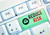 Text Sign Showing Reduce Risk. Conceptual Photo Lessen The Potential Damage That Could Be Caused By  poster