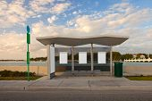 stock photo of bus-shelter  - Bus stop station with white blank advertising panels - JPG