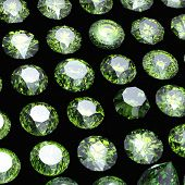 picture of peridot  - Round gemstone on black background - JPG