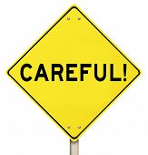 image of safeguard  - The word Careful on a yellow road sign to warn you to be safe from danger or other hazards - JPG