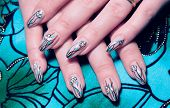 stock photo of nail paint  - Female hands nails with beautiful Art manicure - JPG
