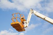 foto of arborist  - a steel basket of a telescopic crane - JPG