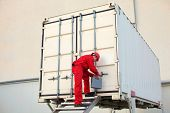 image of movable  - technician with tool case opening movable workshop in container - JPG