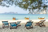 stock photo of koh phi-phi  - Bamboo beach chairs and traditional long - JPG