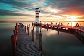 stock photo of lonely  - Lighthouse at Lake Neusiedl at dramatic sunset - JPG