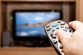 picture of cheer-up  - Hand holding TV remote control with a television in the background - JPG