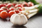 stock photo of vines  - Garlic with cherry tomatoes and spring onions - JPG