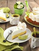 Slice Of Key Lime Pie With Fresh Limes
