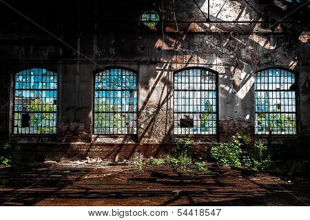 Abandoned industrial interior with bright light poster
