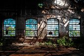 image of windows doors  - Photo Of An Abandoned Industrial Interior With Bright Light - JPG