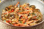 Traditional portuguese seafood dish - cataplana-The cooking process used by the CATAPLANA prevents t