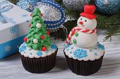 pic of fancy cake  - Two muffins Christmas spruce with toys and a snowman - JPG