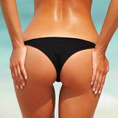 stock photo of bum  - Sexy woman buttocks on the beach background - JPG