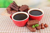picture of cobnuts  - Red cups of strong coffee with chocolate bars on tablecloth on bright background - JPG