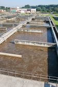 stock photo of turds  - Cleaning construction pool for a sewage treatment - JPG