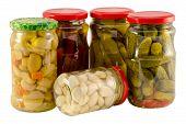 stock photo of pickled vegetables  - set jars of pickled preserved vegetables for winter resource - JPG