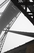 foto of girder  - Abstract steel girder of a train bridge in the fog