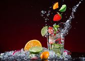 stock photo of cosmopolitan  - Fresh fruit cocktail in freeze motion splashing - JPG