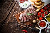 picture of gourmet food  - Delicious beef steak on wooden table - JPG