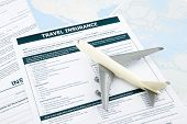 picture of insurance-policy  - travel insurance form and plane model on world map paperwork concept and idea for insurance business - JPG