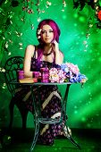 stock photo of loach  - Beautiful young woman sitting under an arch of flowers and overgrown loach - JPG