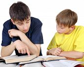 pic of homework  - Older Brother helps Little Brother with a homework on the white background - JPG
