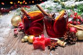picture of hazelnut  - Two glasses of mulled wine with christmas decoration - JPG