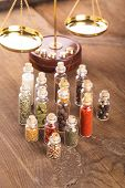 picture of vedic  - Little bottles with spices and scales on the table  - JPG