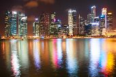 stock photo of singapore night  - Singapore Downtown Core reflected in the river at night - JPG