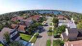 pic of middle class  - Middle class suburban streen and neighborhood in Florida seen from above - JPG