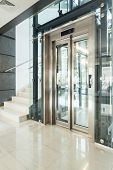 foto of elevators  - Vertical view of elevator in modern building - JPG