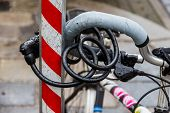 Постер, плакат: a bicycle was taken firmly to prevent the theft of a rod bike lock anti theft lock