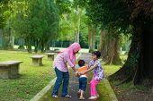 stock photo of southeast asian  - Children playing at outdoor garden park - JPG