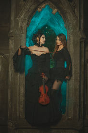 picture of wraith  - Night in the castle two women ghosts with a violin in his hands - JPG