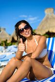 picture of mayan  - Joyful woman at tropical resort caribbean beach doing thumbs up success gesture - JPG