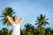 foto of mayan  - Young woman relaxing outdoor on tropical caribbean vacation to Mayan Riviera Mexico - JPG