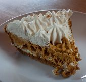 picture of pumpkin pie  - Pumpkin pie with whipping ready to eat during the night - JPG