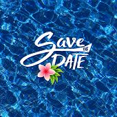 picture of save water  - Save The Date tropical card design with elegant flowing script over sparkling blue water with a fresh pink frangipani flower and green leaves floating on the surface - JPG