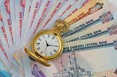 picture of dirhams  - UAE Currency Dirhams with Golden Antique Watch - JPG