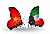 stock photo of kuwait  - Two butterflies with flags on wings as symbol of relations Vietnam and Kuwait - JPG