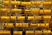 picture of dowry  - golden bracelet hanging displayed in the window shop - JPG