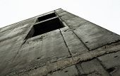image of orifice  - Concrete wall with window openings of the unfinished building against the white sky