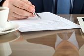 picture of contract  - Businessman is signing a contract business contract details - JPG