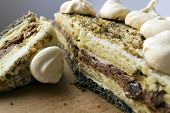 picture of quirk  - Pieces of cake with meringue lying on a wooden board  - JPG